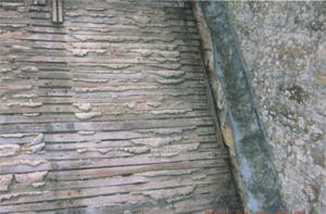 Specialists in re-roofing churches, church porch roof stripped back to the old lath plaster