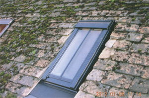 Velux windows added to roof with old stone tiles